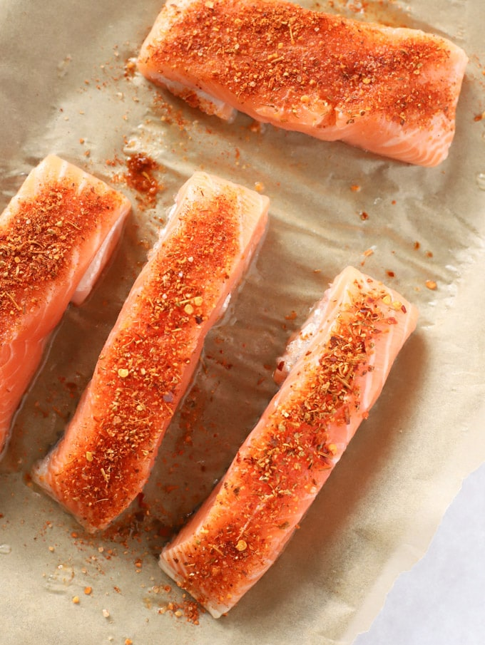 fish fillets with cajun seasoning ready to be baked