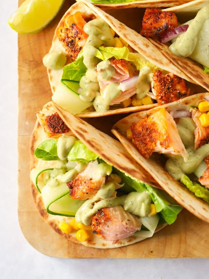 tortillas toasted with fish pieces and avocado dressing