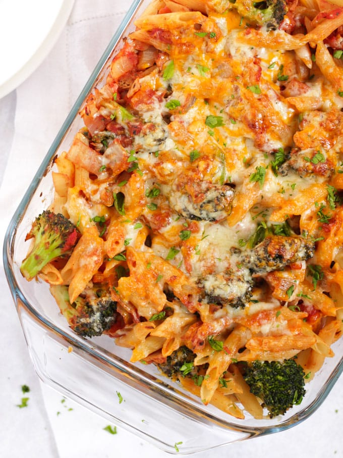 Tuna pasta bake in a glass casserole dish with broccoli