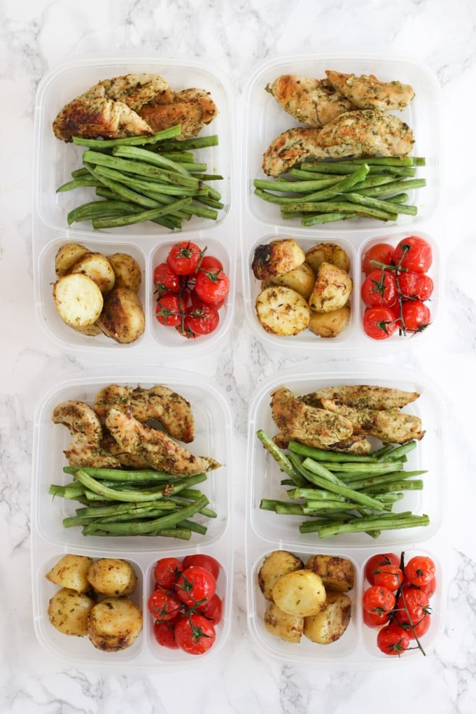 Pesto Chicken meal prep in plastic compartment tubs