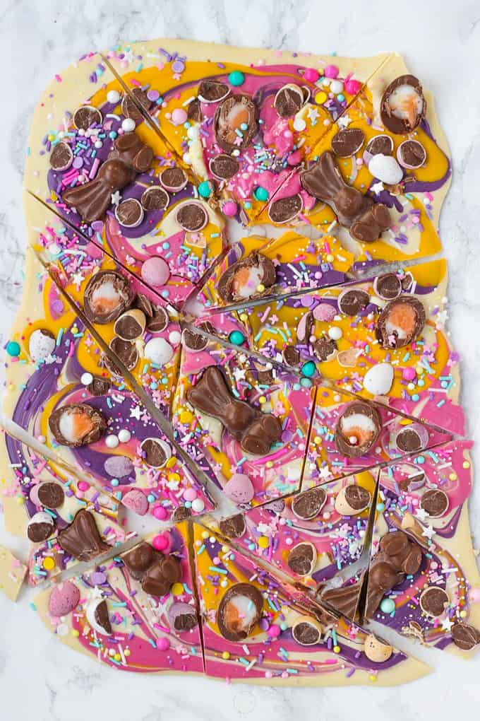 Show stopping Chocolate Easter Bark (with HOW TO VIDEO!). Super simple and easy to make, topped with candy eggs, chocolates and sprinkles, this is a no bake, must make for Easter.