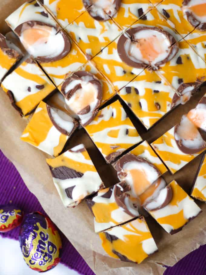 Close up overhead shot of Creme Egg Fudge drizzled with chocolate.