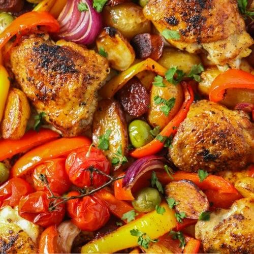 Easy spanish chicken and chorizo tray bake recipe sprinkled with parsley