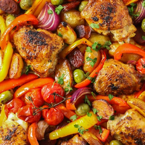 Easy spanish chicken and chorizo tray bake recipe sprinkled with parsley