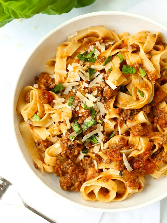 A bowl of bolognese sauce with tagliatelle