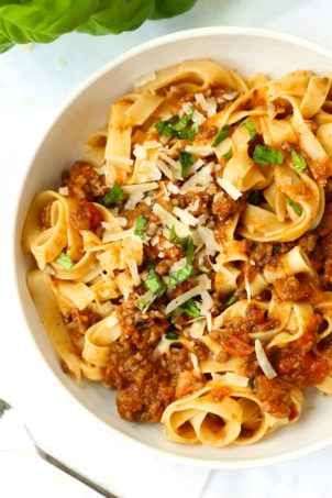 Bowl of spaghetti bolognese with parmesan and basil