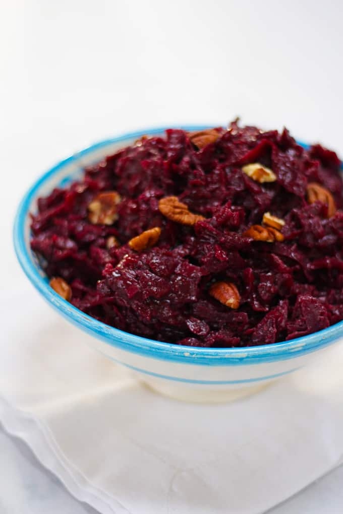 Braised red cabbage - the perfect make ahead vegetable side dish. Slow cooked with spices, apple and cider.
