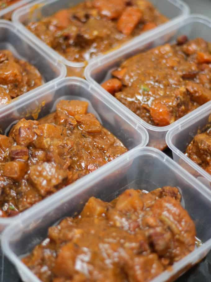 Takeaway containers full of beef Guinness stew ready for home freezing.
