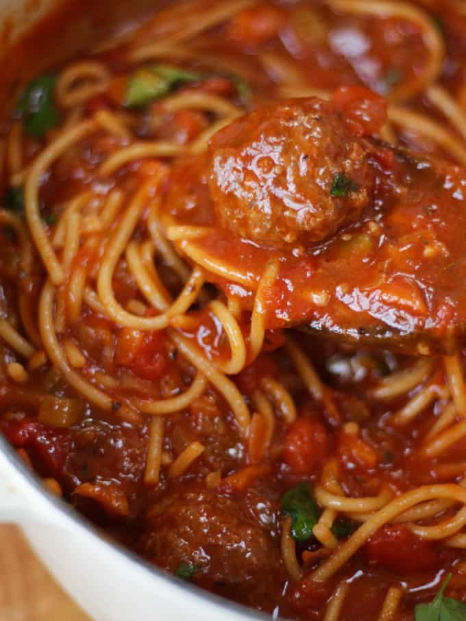 Spaghetti and meatballs in a tomato sauce overhead close up.