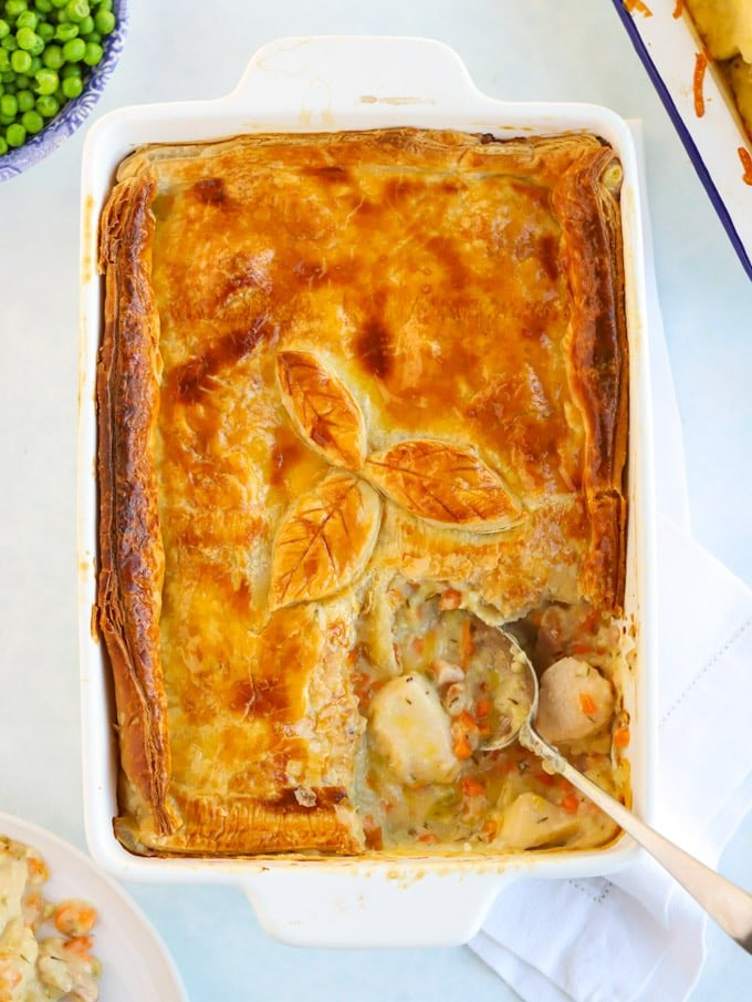 Puff pastry chicken pie recipe with a spoon in the pie