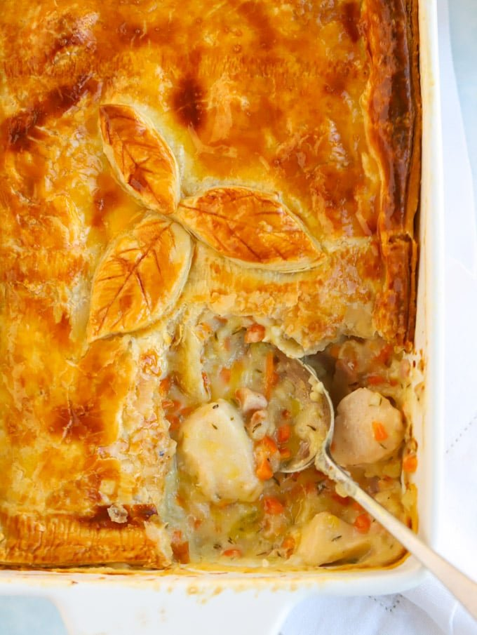 Chicken pie recipe with vegetables and puff pastry top baked until golden