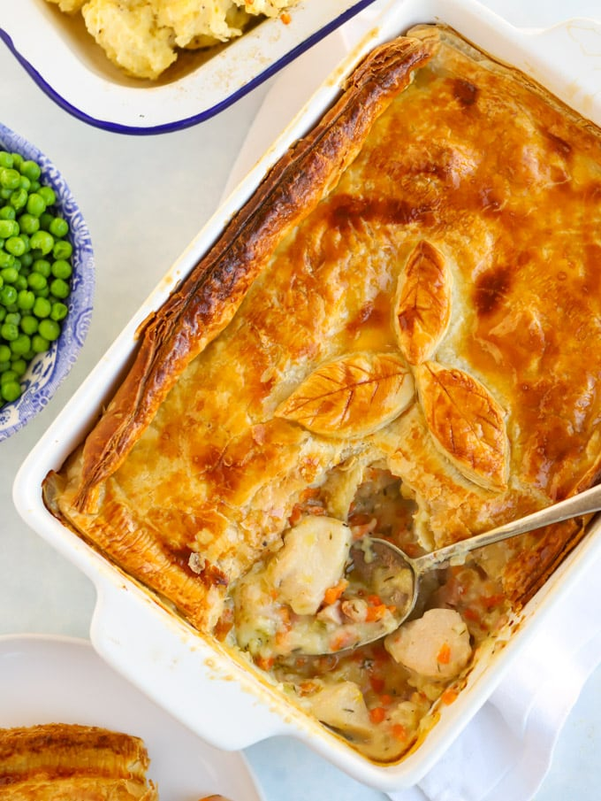 Chicken pie recipe served with peas and mashed potato