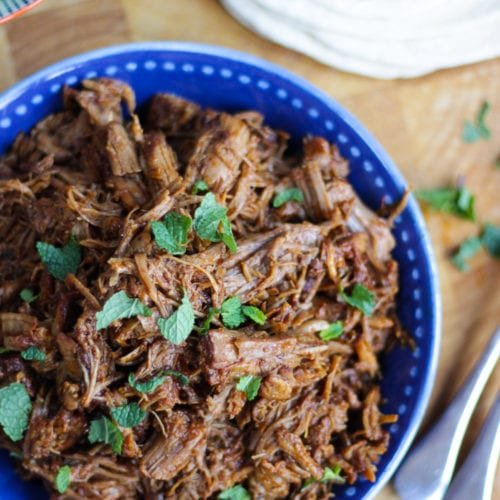 Instant Pot Pulled pork in a blue bowl with wraps