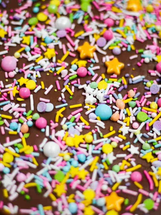 Slab of candy sprinkled with colourful sprinkles.