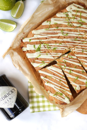 These Gin and Tonic Cake Bars are super simple and delicious. An easy cake packed with gin and tonic flavour, with zesty lime and a crunchy glaze. Based on a lemon drizzle cake style recipe, with gin infused syrup and topped with white chocolate. #ginandtonic #cakerecipe #easydessert #tamingtwins