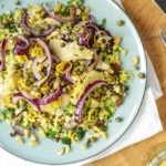 Cauliflower couscous with artichokes & capers from Beautifully simple at Waitrose on a teal green coloured plate and white napkin.