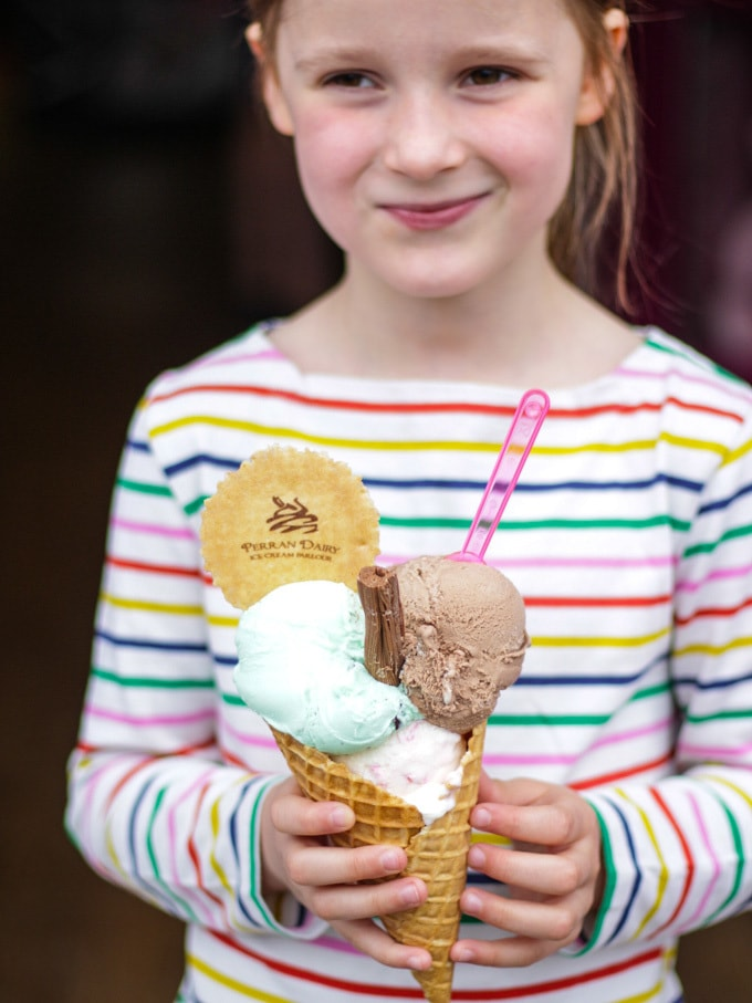Girl holding giant cone of ice cream with green, brown and white ice cream (mint and chocolate) plus wafer and spoon with striped top in the background in Perranporth - Perran Sands, Haven holiday park. How to make easy peasy Homemade Fish Fingers using our simple recipe. Just four ingredients and supper tasty family meal every time.