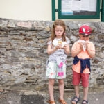 Girl and boy eating traditional Cornish pasties in St Agnes in St Trevicks Pasties - Perran Sands Holiday Park from Haven. Top 5 foodie things to do in and around Perranporth, Cornwall. If you're staying at Haven, Perran Sands, here are some recommendations for the best food, restaurants and places to eat nearby.
