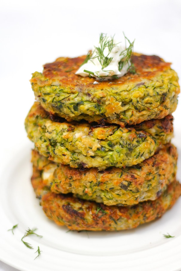 Easy Courgette Fritters Recipe - Oven Baked with Feta Cheese - These healthy and simple Courgette Fritters (or Zucchini Fritters) are perfect for all the family. Made with feta cheese, and baked in the oven, they are a delicious fresh dinner. #courgettefritters #vegetarian #vegetarianmeals #zucchini #zucchinifritters #tamingtwins
