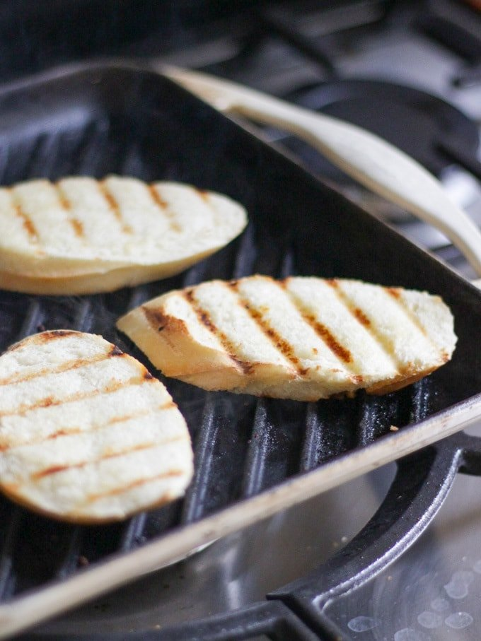 Griddled slices of white break on a Le Creuset griddle pan to go with Smoked Mackerel Pate.