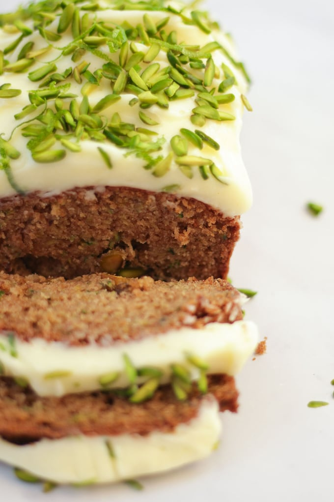 This delicious Courgette Cake recipe is so easy to make, packed with lime and topped with delicious mascarpone cream cheese frosting icing. The perfect summer bake to use your vegetables in! Also easily made Gluten Free. #courgettecake #cakerecipe #easycake #summercake #tamingtwins #zucchini #zucchinicake