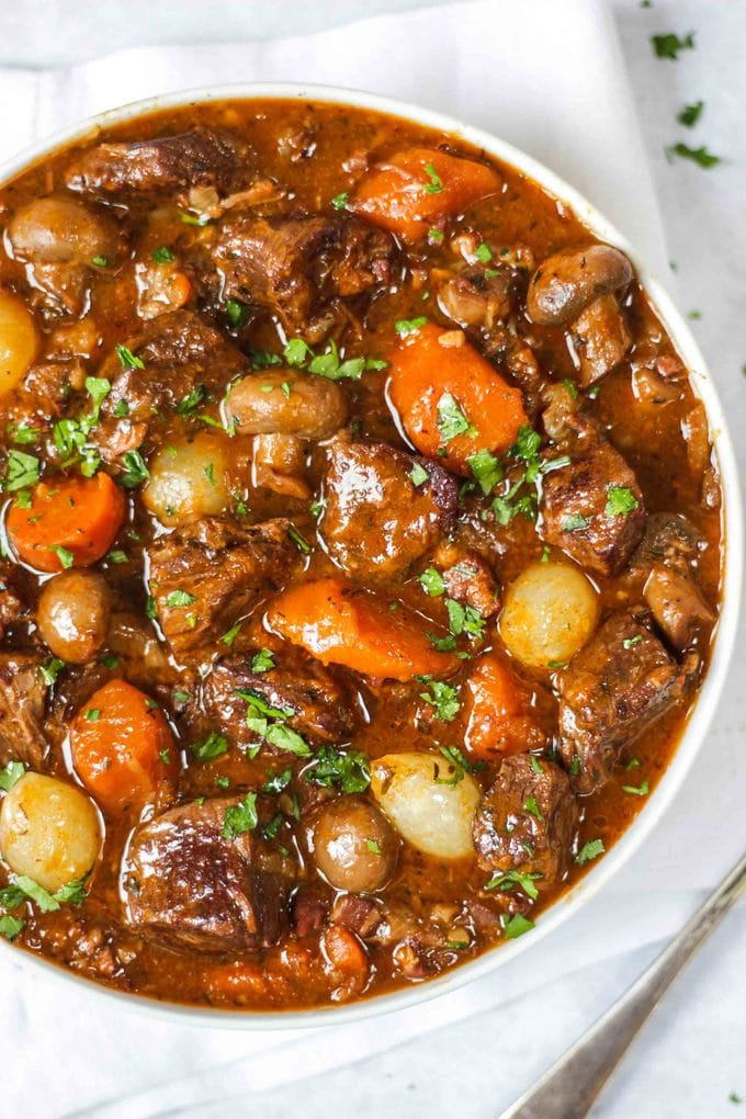 Beef Bourguignon - Easy & Delicious Beef Stew Recipe. The perfect winter warmer dinner. Ideal for freezing, cooking in the pressure cooker, Instant Pot or slow cooker. Just like Julia Child, this French recipe is a favourite in our house! Also easily adaptable to be Slimming World friendly and gluten free. #tamingtwins #beefbourguignon #beefstew #pressurecookerrecipes #instantpotrecipes #freezermeals #freezerrecipes #winterrecipes #autumnrecipes #beefcasserole #frenchfood
