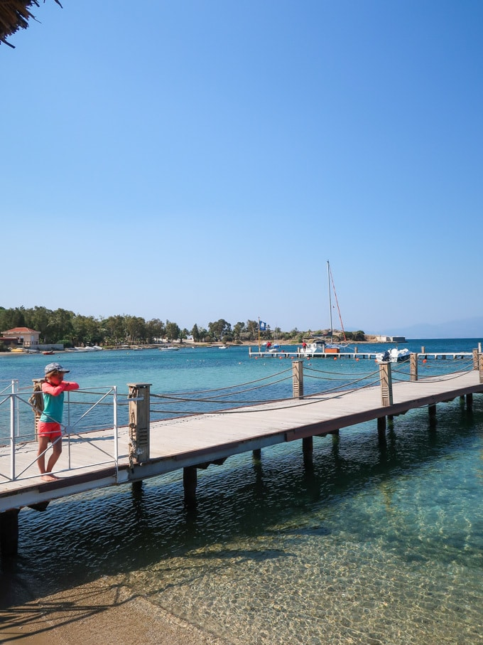 Girl standing on jetty at Phokaia restort in Turkey Mark Warner.