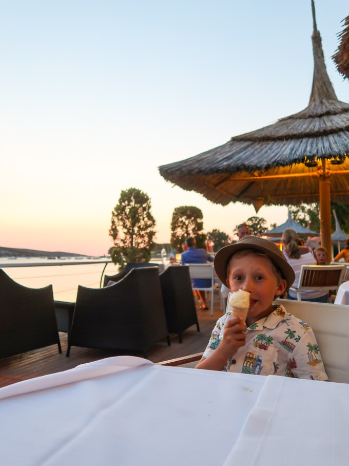 Boy eating ice cream in a hat at Phokaia restort in Turkey Mark Warner.