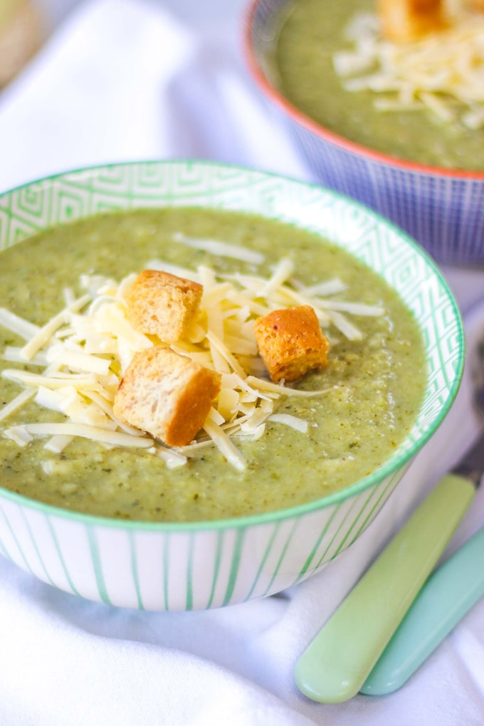 BROCCOLI AND CAULIFLOWER SOUP - This easy Broccoli and Cauliflower Soup recipe makes a family friendly lunch in minutes. Use frozen vegetables to keep things super simple. The child friendly version of Broccoli Stilton Soup, packs a punch with two portions of vegetables and plenty of taste. With a sprinkle of cheddar cheese and croutons for added taste and texture. This is also gluten free and vegetarian (if using vegetarian cheese and gluten free croutons) #tamingtwins #glutenfree #souprecipe