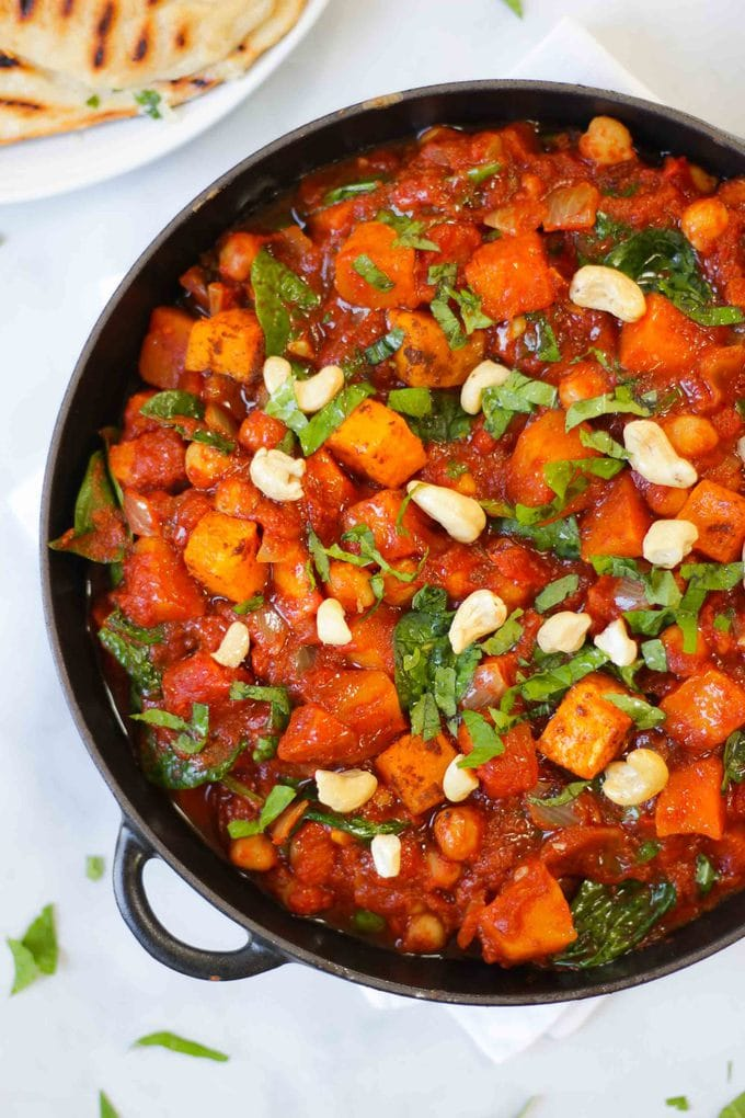 ROASTED BUTTERNUT SQUASH CURRY - ThisButternut Squashcurry is a really warming vegetarian meal. Roasted butternutsquash, with spinach and chickpeas mixed with Indian spices make this a comforting dish perfect for the wholefamily. It is dairy and gluten free and would be suitable for vegans. It is also a brilliant recipe for batch cooking andfreezing ahead for those midweek nights.#tamingtwins #butternutsquash #vegetarian #curryrecipe #curry #vegetariancurry #buternutsquashrecipe #bns