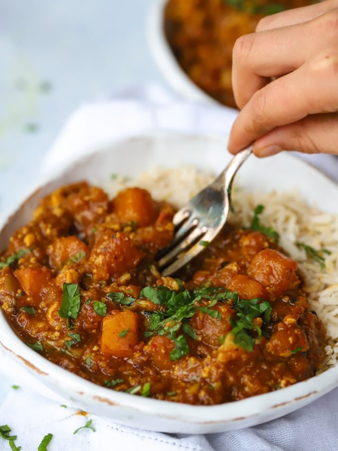 Easy vegan curry recipe in bowl with fork