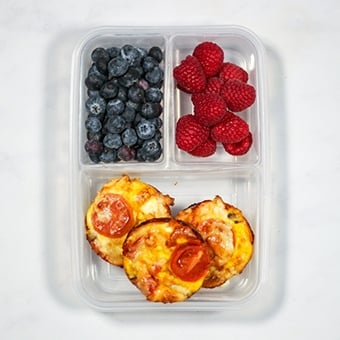 Mini quiches in a plastic lunchbox as a healthy packed lunch