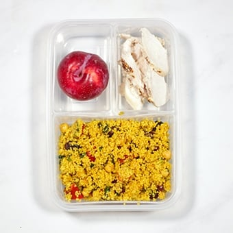 Healthy lunch idea, a cows cows chicken salad in a compartment lunchbox