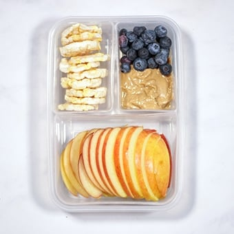 healthy lunch idea, apple, peanut butter and rice cakes