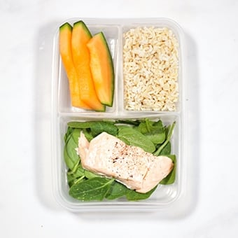 Healthy lunchbox idea of salmon, spinach and rice