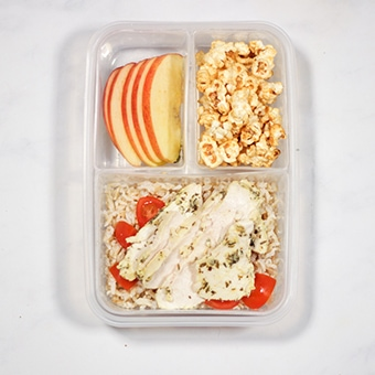 Chicken and rice lunchbox salad in a compartment packed lunchbox