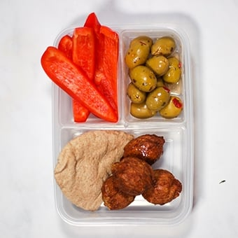 lunchbox with compartments filled with falafel, healthy lunch idea for work