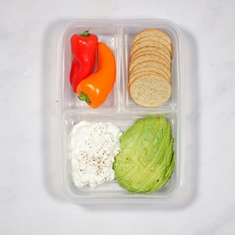 plastic lunchbox with avocado and cottage cheese, healthy lunch idea for work