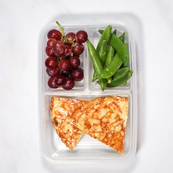 Frittata in a plastic lunchbox as healthy lunch idea for work