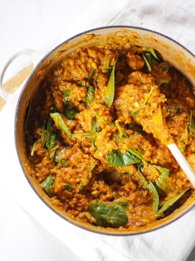 red lentil dahl recipe with spinach just stirred in