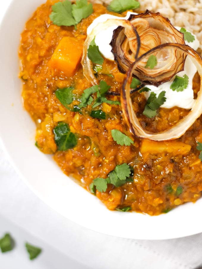 a bowl of Dahl with butternut squash and red lentils sprinkled with coriander