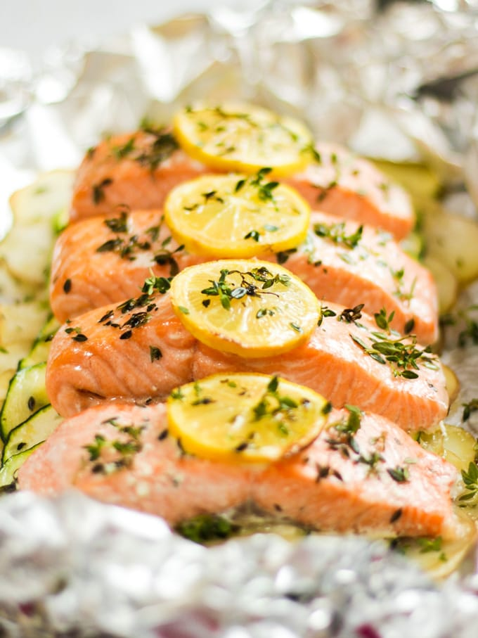 Salmon fillets with lemon slices cooked in foil