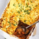 Vegetable Moussaka bake recipe in a white dish with spoon