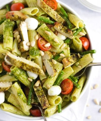 Easy chicken pasta with green pesto, veggies and cheese