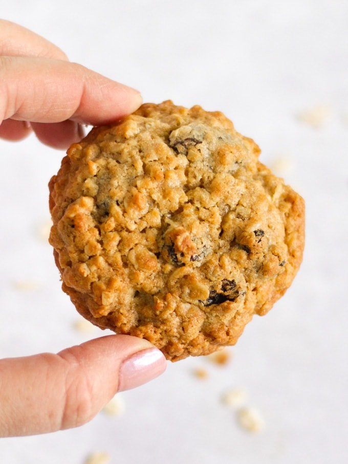 Fingers holding an easy and healthy oat biscuit