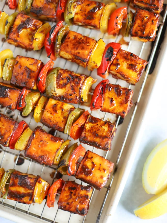 Cubes of paneer cheese with tikka spices cooked on a rack.