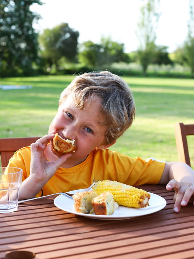 Boy eating a muffin