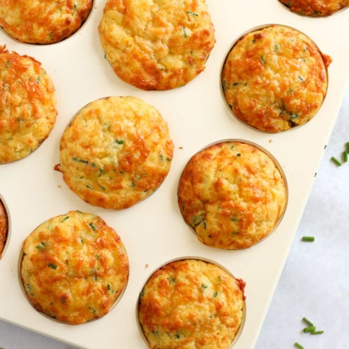Easy savoury muffins topped with cheese and packed with corn