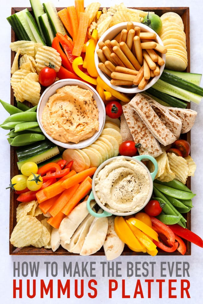 Hummus platter with dips and vegetables, including cucumber and peppers for kids