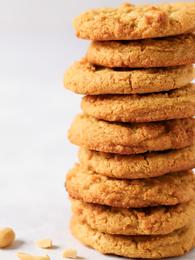 stack of cookies piled high with peanuts